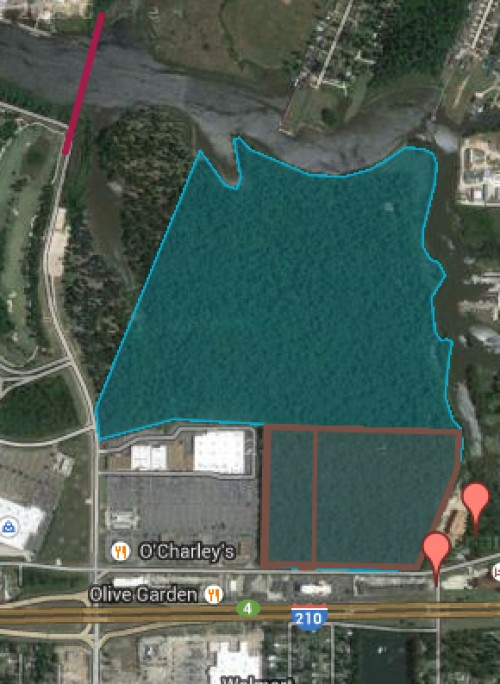 134 Acres bordering Prien Lake Rd, Nelson Rd, and 4,000' on Contraband Bayou!